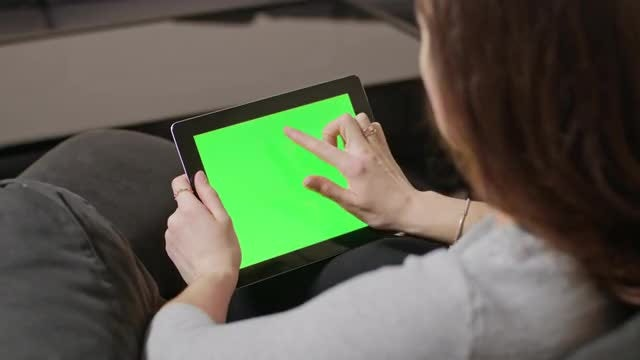 Woman Tapping On Tablet Screen: Stock Video