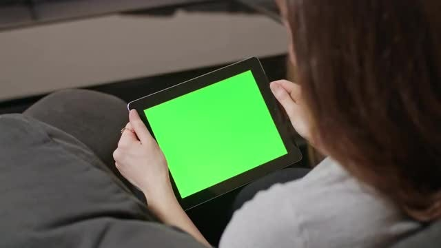 Woman Reading On Tablet PC: Stock Video