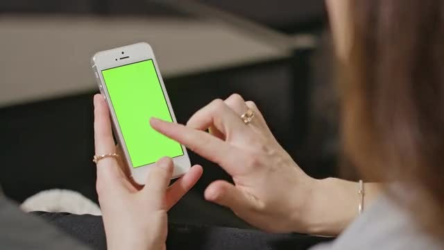 Woman Tapping On Smartphone: Stock Video