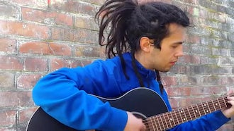 Young Man With Dreadlocks Playing Guitar: Stock Video