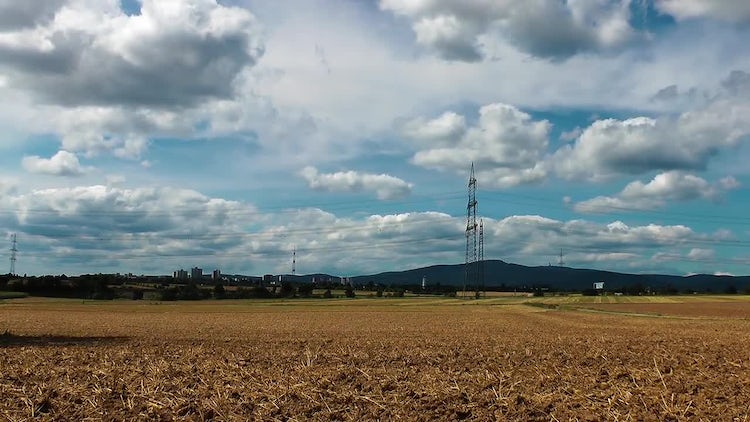 Field And Electric Poles Cloudy Day: Stock Video