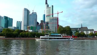 Towers And Ferryboat Near River In Frankfurt: Stock Video