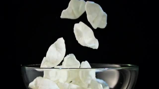 White Chips Falling In Bowl: Stock Video