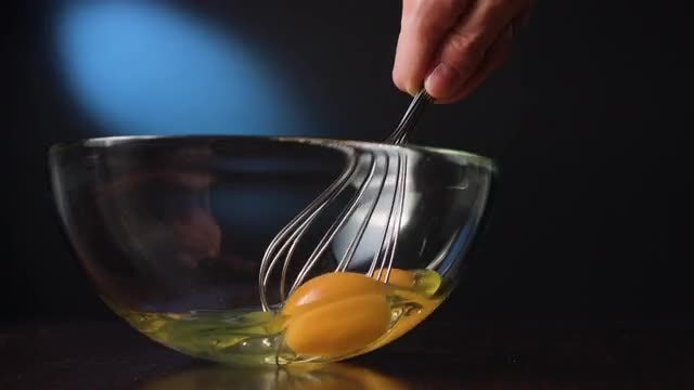 Whisking Eggs In Glass Bowl : Stock Video