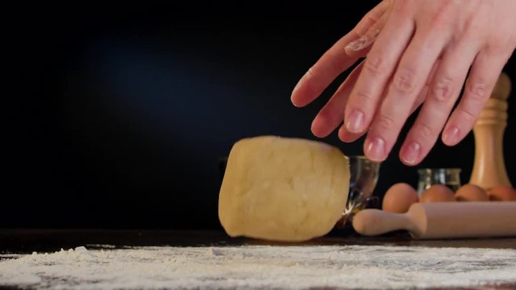 Throwing Dough On Table: Stock Video