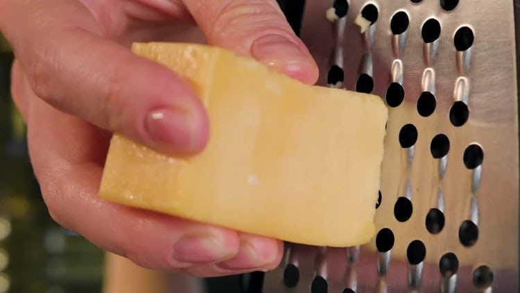 Female Hand Grating Cheese: Stock Video