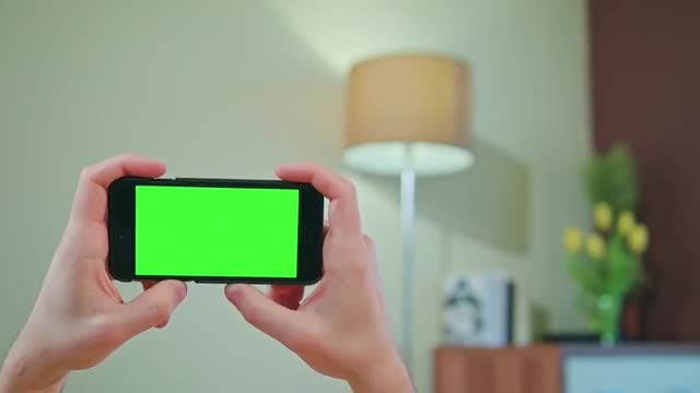Holding Green Screen Phone Horizontally : Stock Video