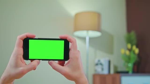 Holding Green Screen Phone Horizontally : Stock Video