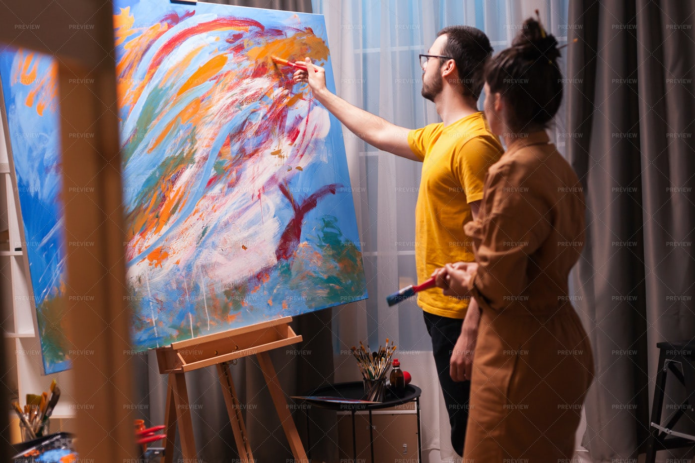 Collaborating On A Painting: Stock Photos