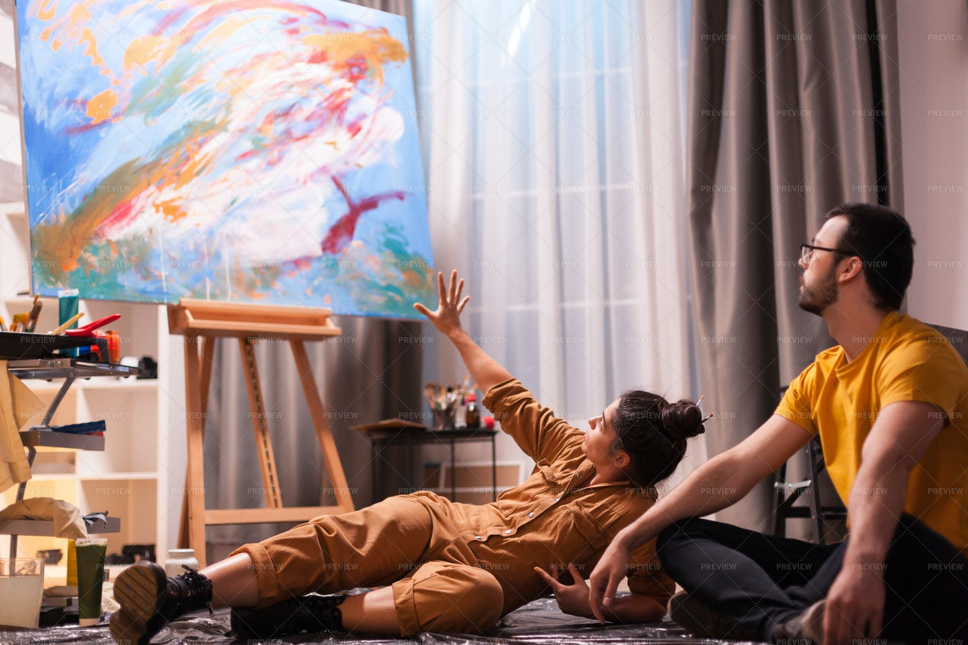 Discussing Her Painting: Stock Photos