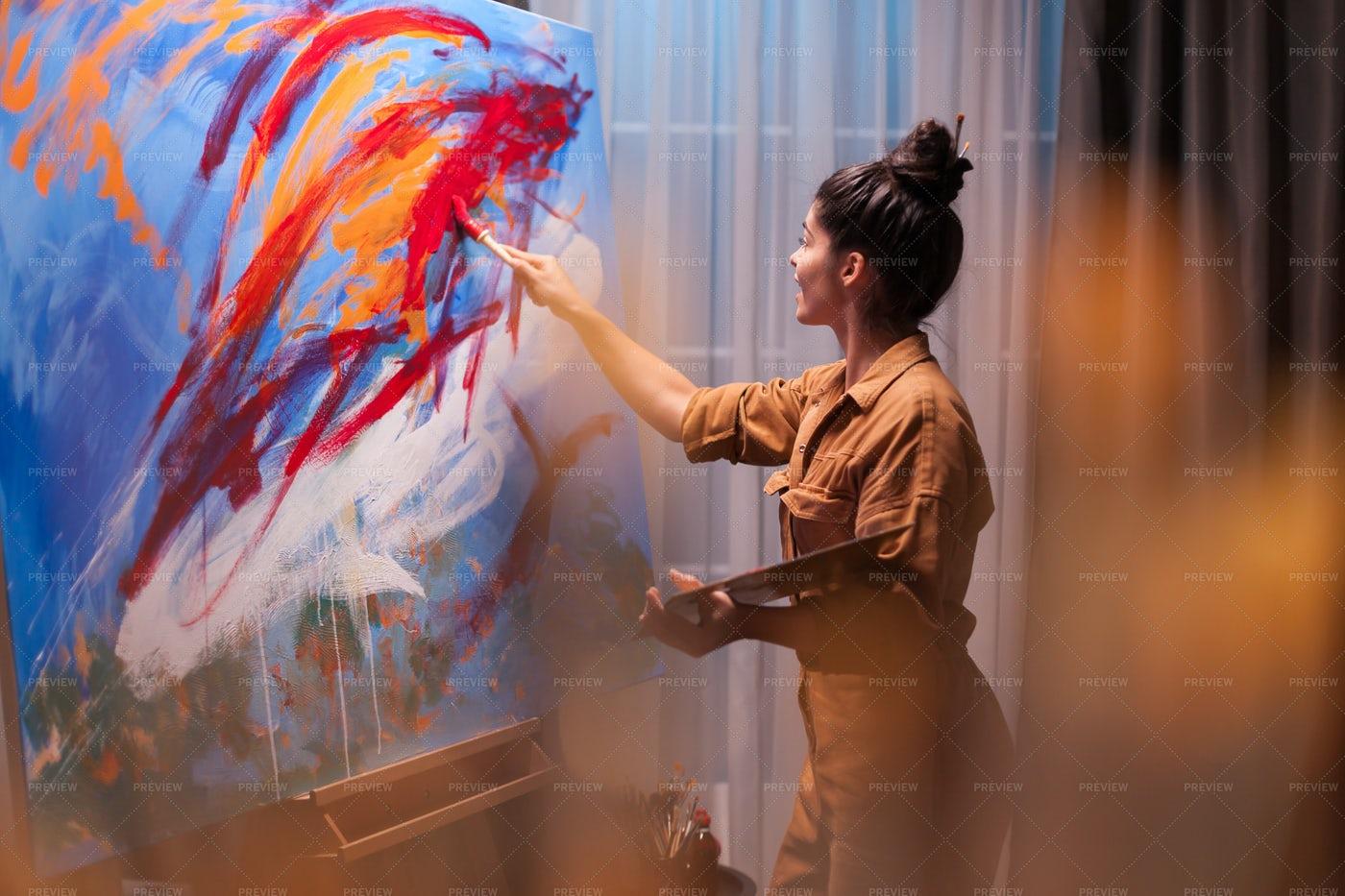 Painting Her Masterpiece: Stock Photos