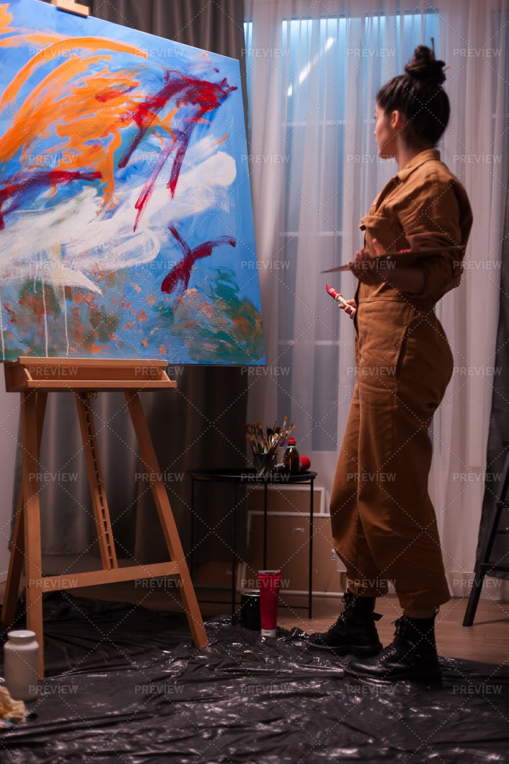 Woman Admiring Painting: Stock Photos