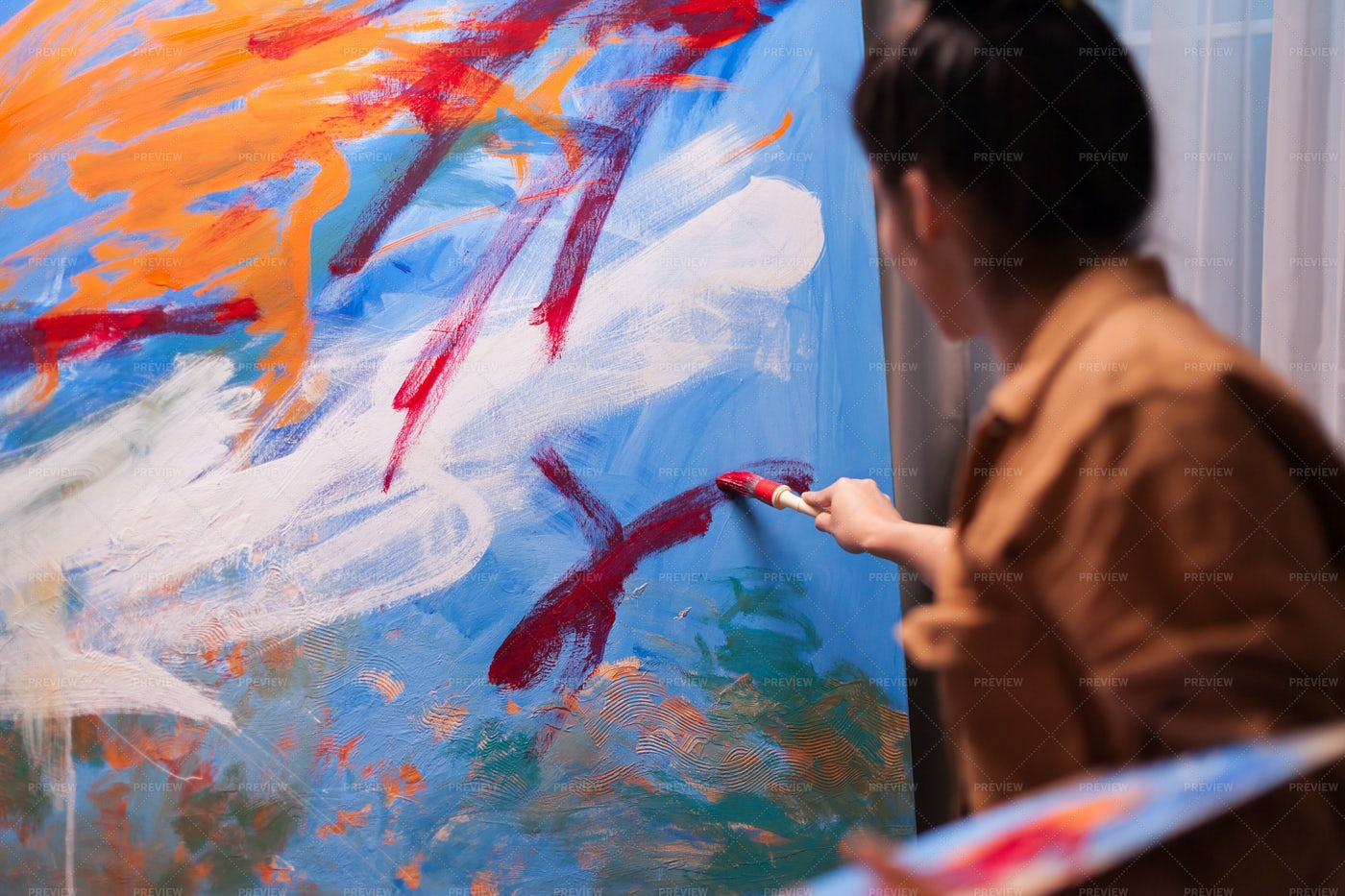 Woman Painting: Stock Photos