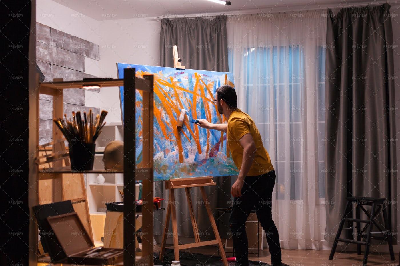 Painter Using Roller: Stock Photos