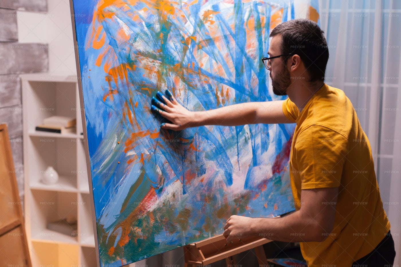 Painting With His Hands: Stock Photos