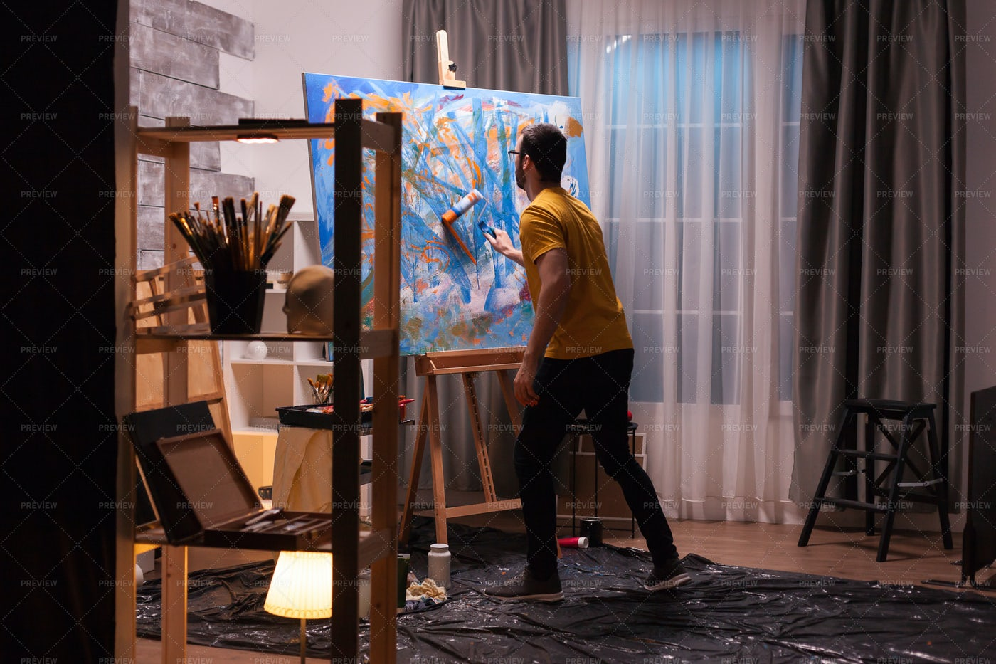 Fine Artist Painting With Roller: Stock Photos