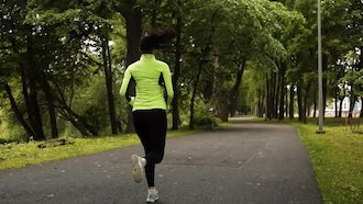 Woman Jogging Slow Motion: Stock Video