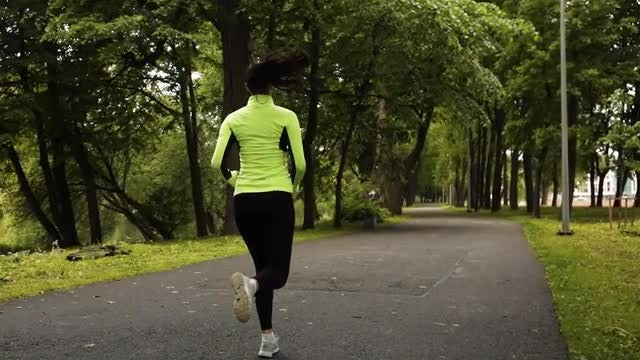 Woman Jogging Slow Motion: Stock Video