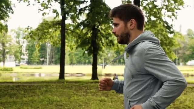 Man Running At The Green Summer Park: Stock Video