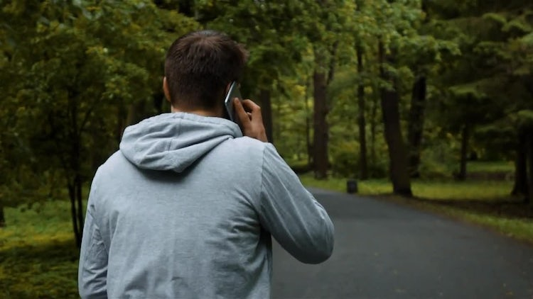 Jogger Answers Phone: Stock Video