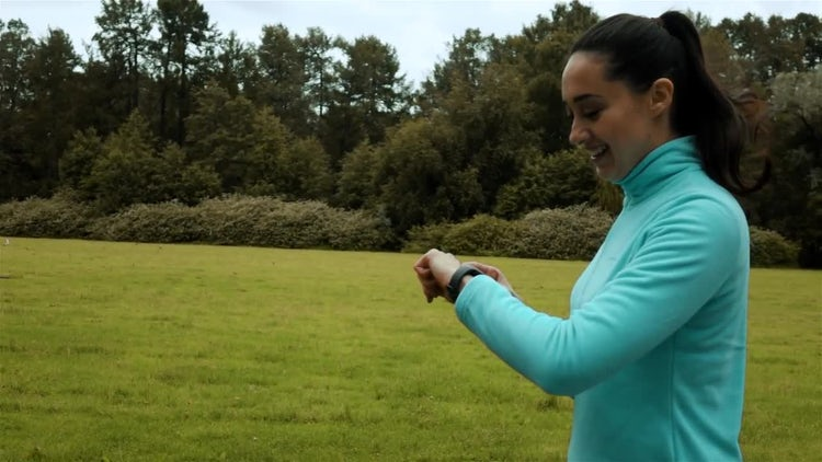 Jogger Checks Smart Watch: Stock Video