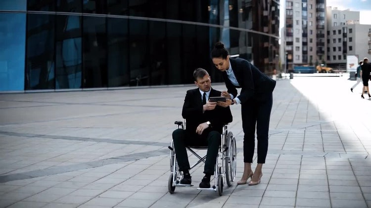 Boss In Wheelchair His Employee With Tablet: Stock Video