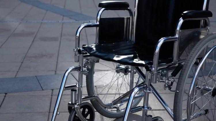 Wheelchair Near Modern Building.: Stock Video