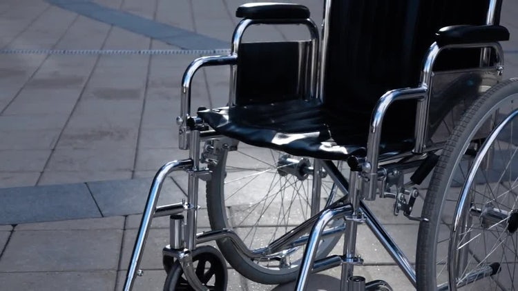 Wheelchair Near Modern Building.: Stock Video