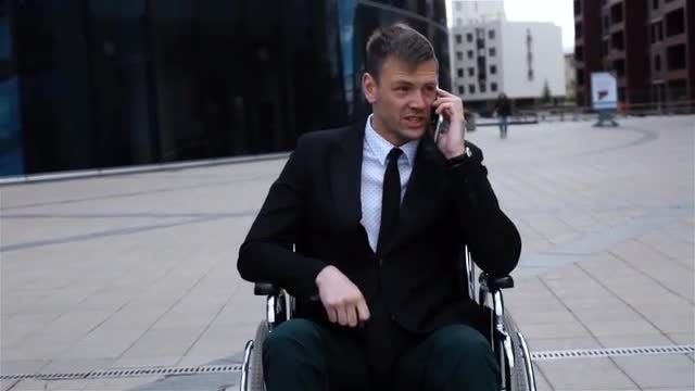 Call For Businessman In Wheelchair : Stock Video
