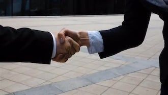 Business Partners Doing Handshake: Stock Video