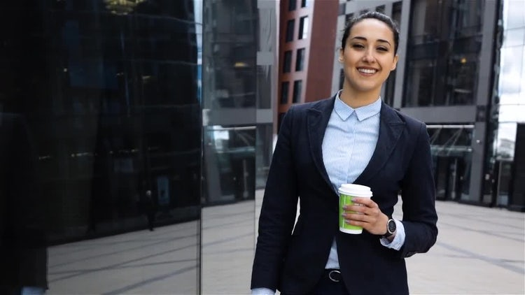 Smiling Businesswoman Holding a Coffee: Stock Video
