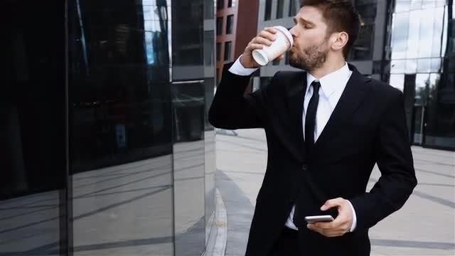 Businessman On a Coffee Break: Stock Video