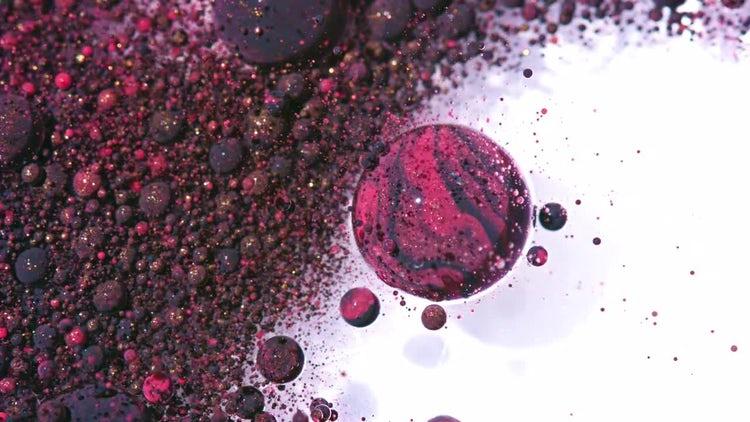 Purple Oil Bubbles in Motion: Stock Video