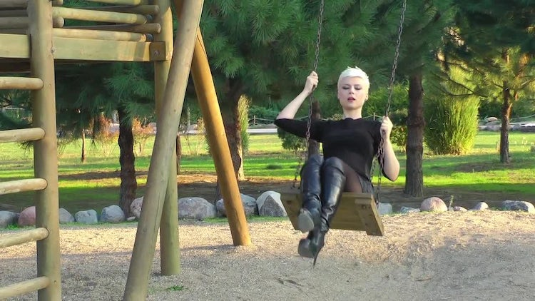 Blond Woman In Playground In Park: Stock Video