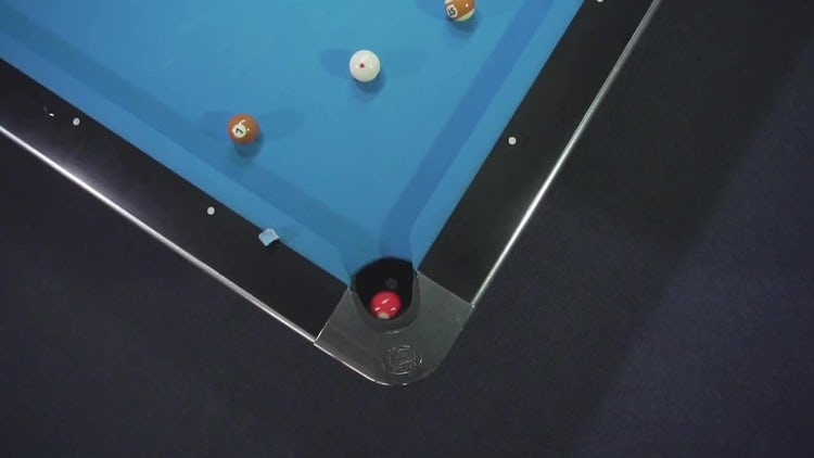 Red Ball Into The Hole: Stock Video