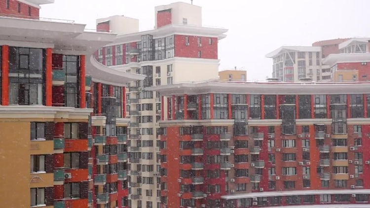 Snow Falling On Red Apartments : Stock Video