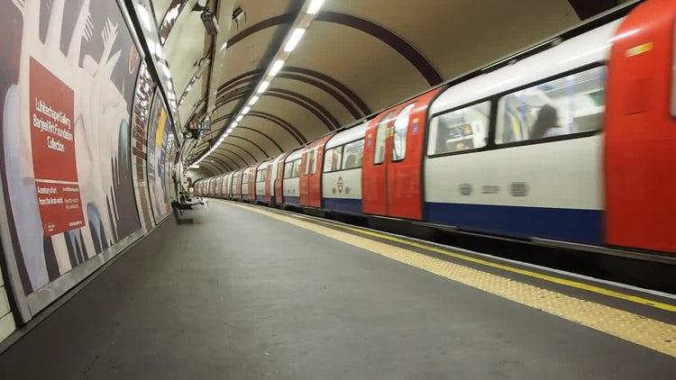 Tube Train Approaches Platform: Stock Video