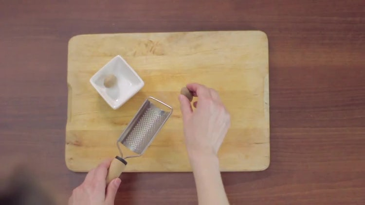 Top View of Grating Nutmeg: Stock Video