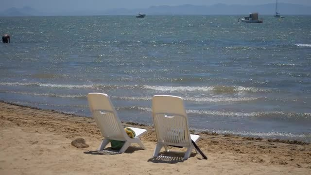 Two Beach Chairs: Stock Video