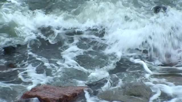 Waves Crash Onto Shoreline: Stock Video