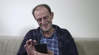 Mature Man Enjoying A Smartphone: Stock Video