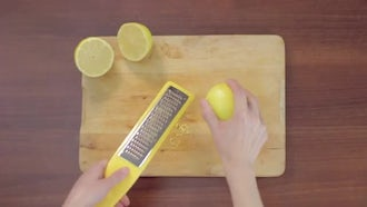 Grating A Lemon: Stock Video