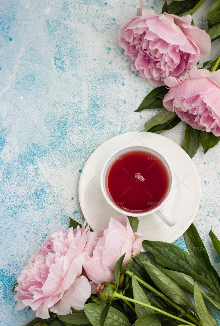 Tea Beside Pink Peonies: Stock Photos