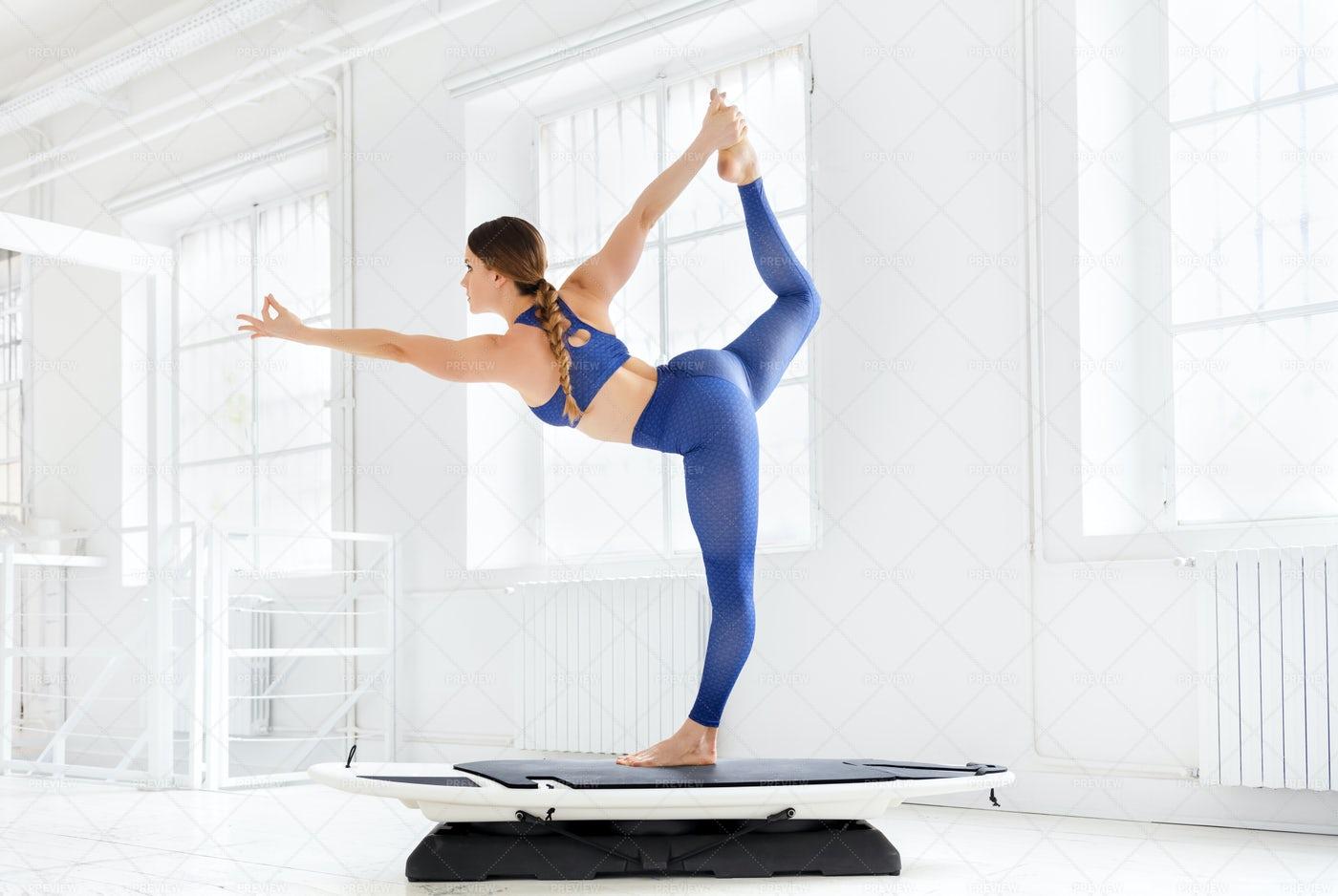 Woman Doing A Dancer Pose: Stock Photos