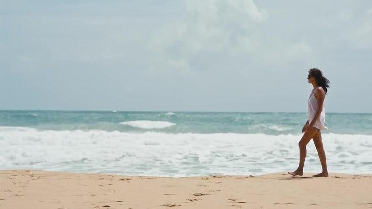 Woman Walking Along Beach: Stock Video