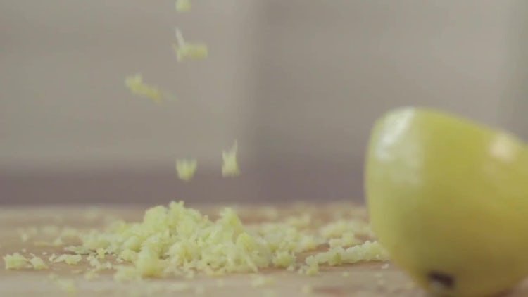 Lemon's Zest Falling On Cutting Board: Stock Video
