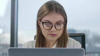Lady With Eyeglasses On Computer : Stock Video