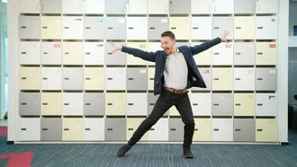 Young Businessman Dancing Indoors: Stock Video