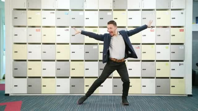 Young Businessman Dancing Indoors: Stock Video