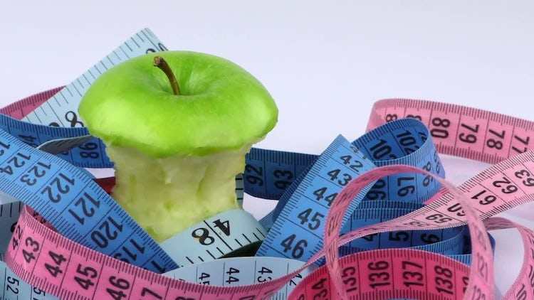 Apple And Tangled Measuring Tape: Stock Video